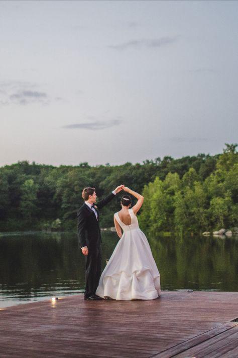The bride and groom twirling on the dock at lakefront wedding venue in NJ, Rock Island Lake Club | Photographer: The Willinghams #njweddingvenue #bride #weddingdress #brideandgroom #weddingday #weddingdayphotos #weddingphotos #brideandgroomphotos #outdoorwedding #lakewedding #njweddingvenues #rockislandlakeclub