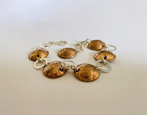 """""""Fun artisan copper and sterling bracelet of round, open silver links and six - 1952 domed pennies. Whimsical bracelet that has great shine and the pennies add that warm copper glow. It measures about 7½\"""" long by ⅝\"""" wide with a secure lobster claw clasp. The bracelet is made so the clasp connects right before the last penny - leaving that last penny to dangle. Wonderful alone or as s stacking bracelet, this great piece is in pristine vintage condition with free First Class domestic shipping. U"""