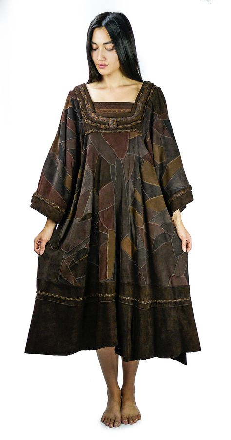 Vintage 1970s handmade patchwork suede leather dress. Leather braiding  along chest and bell sleeves. Organic shaped earth tone leather patches.  Dress weighs a significant amount due to layers of leather. One of a kind  and very Native Funk & Flash!