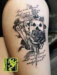 What does card tattoo mean? We have card tattoo ideas, designs, symbolism and we explain the meaning behind the tattoo.