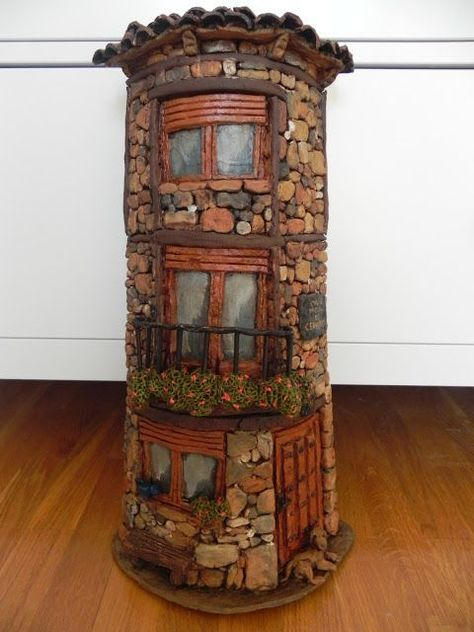 Rock tower faerie house- cover a Pringles cannister? Would be cute in the yard amongst the plants! – DIY Fairy Gardens   -  #DIYFairyGardenMoney #DIYFairyGardenSucculents #DIYFairyGardenTerrarium