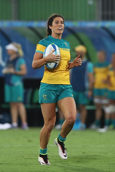 Charlotte Caslick of Australia looks on during the rugby match against Spain on Day 2 of the Rio 2016 Olympic Games at Deodoro Stadium…