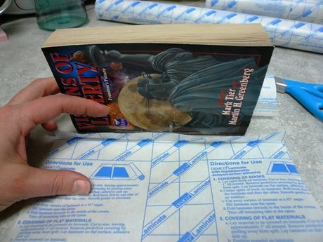 How To Cover A Paperback Book With Clear Plastic Film Plastic Book Covers Book Cover Diy Diy Book