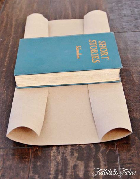 TidbitsTwine Kraft Paper Book Covers Step 3 DIY Stamped Kraft Covered Books A step-by-step tutorial for covering books with Kraft paper and stamping them for a decorative look! A stamped book is a great display option! Paper Book Covers, Vintage Book Covers, Cover Books, Covering Books With Paper, Folded Book Art, Book Folding, Farmhouse Books, Farmhouse Decor, Rustic Books