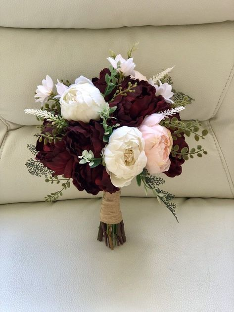 bridesmaid bouquets Gorgeous large silk peony bouquet featuring burgundy, blush, and cream peonies with greenery accents. Tell me what color ribbon youd like! This bouquet ca Peony Bridesmaid Bouquet, Blush Bouquet, Bridal Bouquet Fall, Fall Wedding Bouquets, Peonies Bouquet, Fall Wedding Flowers, Flower Bouquet Wedding, Floral Wedding, Bridal Bouquets