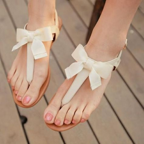 2014 flat wedding sandals, cream sandals with bows. The more I think about it, the more sense it makes to wear sandals, since it will likely be August when we get married…