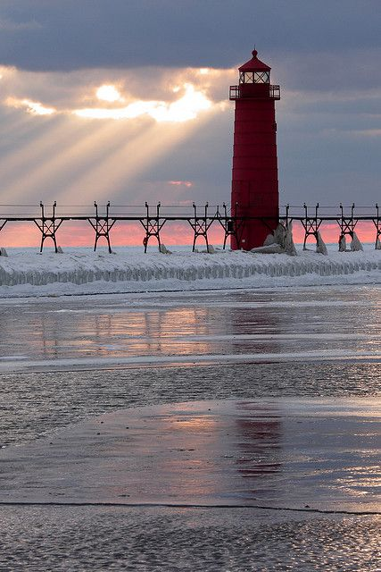 Grand Haven, Michigan... pinks, grays and bluish grays with a little white remind me of the pic of the day and the light house is standing like the couple of trees.