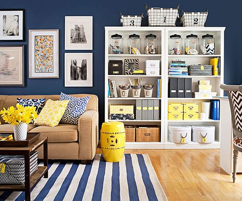 Stuff a bookshelf with gorgeous storage for easy access! More ideas: http://www.bhg.com/rooms/living-room/family/declutter-your-living-room/?socsrc=bhgpin020215stuffabookshelf&page=1
