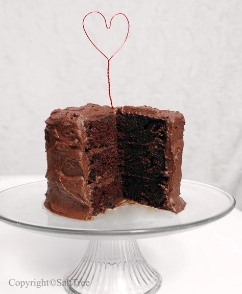 A chocolate cake for someone who can't indulge in sweets because of dietary restrictions like diabetes.    I made this cake for my papa.  It uses sweetener and sweetener / sugar blends in place of regular sugar (including the icing), but still maintains an indulgent almost fudgy consistency, loaded with chocolaty flavour, and just enough sweetness.  Now it can't be called a 'sugar free' cake, but it's pretty darn close.