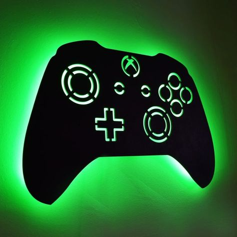 "gamer room This awesome XBOX inspired LED lighted controller sign is the perfect ""wow factor"" for your game room, dorm room, or any fun space!The artwork panel is spaced off the wall, for a Video Game Xbox, Video Game Font, Video Game Decor, Video Game Bedroom, Video Game Rooms, Game Art, Boys Game Room, Room Boys, Xbox 360"
