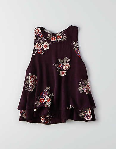 I like this plum color and the cut of this shirt. I also sort of like the floral pattern, but I'm not quite sure if I would like it on me.