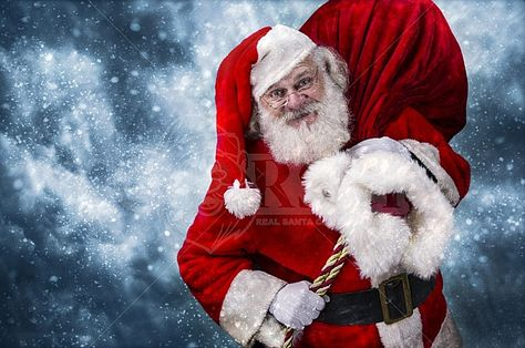 A real authentic Christmas photo of Santa Claus carrying his gift sack. Real Santa Pictures and This images can be licensed to use at realsantaimages.com | Do Not Use Without A License
