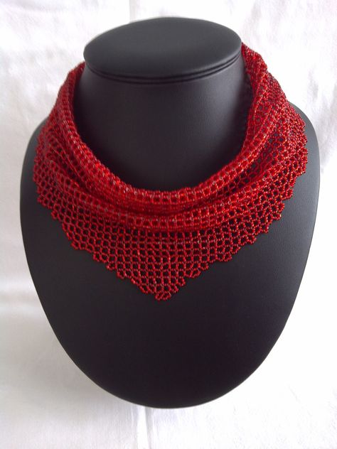 DamnedHalo's beaded scarf: Basically a right angled square folded over in the middle.