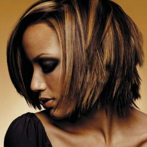 Dark brown hair with Carmel colored highlights.  Really like this!