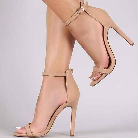 This alluring heel features a nubuck vegan leather upper, open toe silhouette, a.