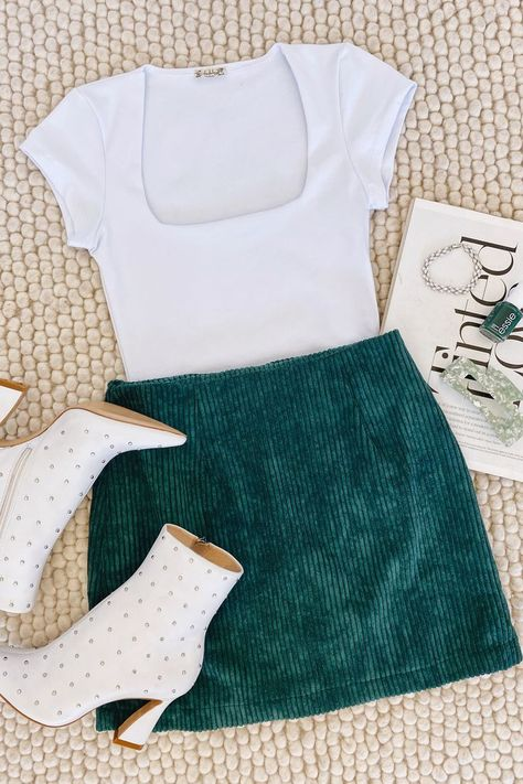 Say hello to a new fall outfit! Lulus High Class Emerald Green Corduroy Mini Skirt and Square Eyes White Bodysuit are the perfect staples for the season. Add white boots to complete the look. #lovelulus