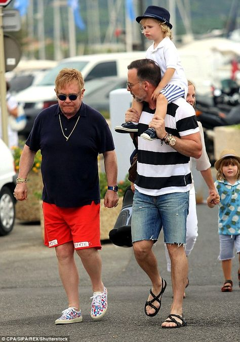 Happy families: Elton and David - who made their union official in December 2014 - welcome...