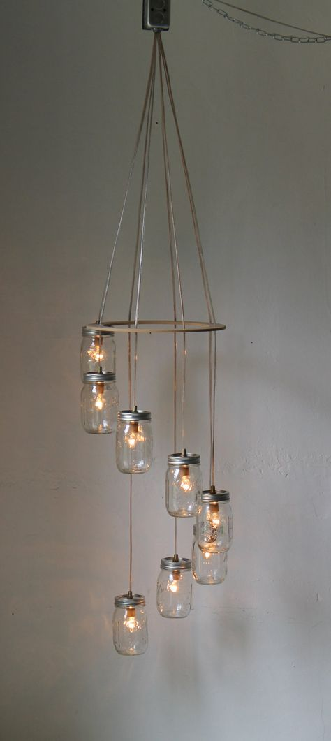 Spiral Carousel Mason Jar Chandelier Mason Jar Lighting Swag Lamp Handcrafted Upcycled BootsNGus Hanging Pendant Light Fixture. $200.00, via Etsy.