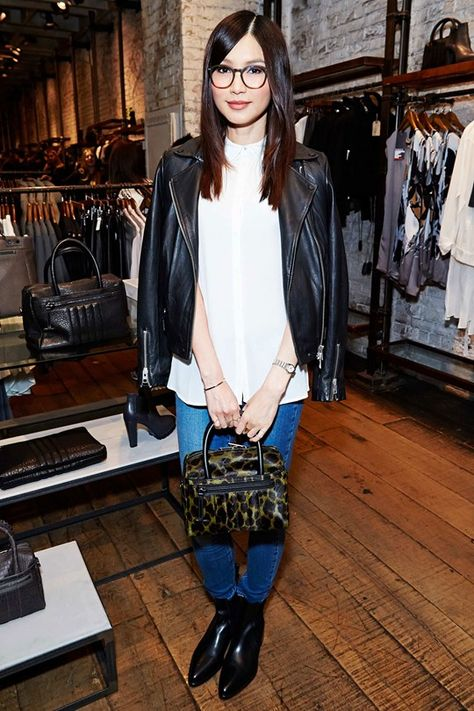 Gemma Chan brought cool-girl geek chic to her classic AllSaints denims and button up, topping off the look with shoulder-robed leather jacket. Cute specs, too.