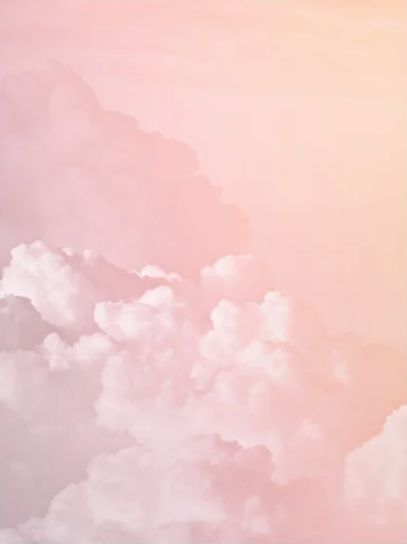 Amazing plane view with pastel pink colorful cotton blush and candy sky with so many clouds and poetic travel view. Shop this poster, art print or frame for your wall in your home decoration by Society6.