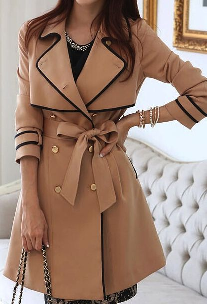 Camel colored trench. Classic but this style is a feminine twist.