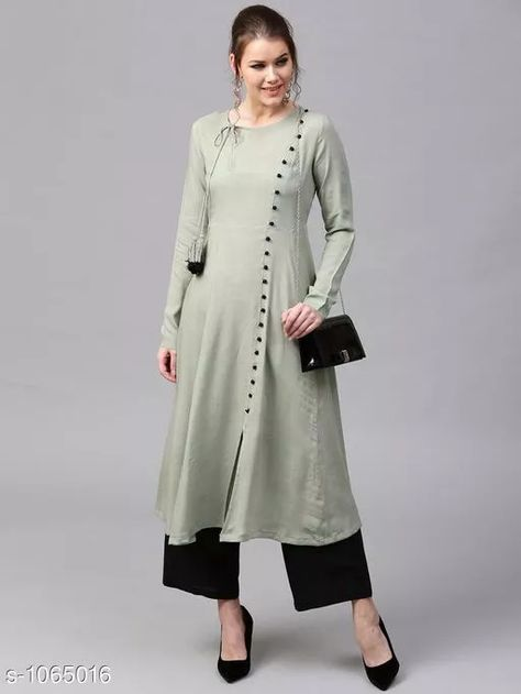 Fashionable Women Kurta Set Fabric: Kurti: Rayon, Palazzo: Rayon  Sleeves: Full Sleeves are Included Size: Kurti - L - 40 in, XXL - 44 in Palazzo - L - 32 in, XXL - 36 in Length: Kurti: Up To 48 in, Palazzo: Up To 38 in Type: Stitched Description: It Has 1 Piece Of Kurti With Palazzo Work: Kurti: Button Work, Palazzo: Solid  For Business WhatsApp +918010630338
