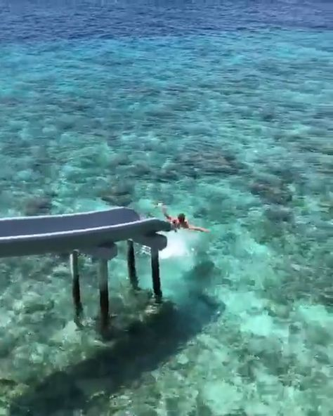 This Maldives resort is the perfect tropical destinations. Wake up and go down your own private ocean slide. Soneva Fushi is the perfect luxury resort. #maldivesresort #maldives
