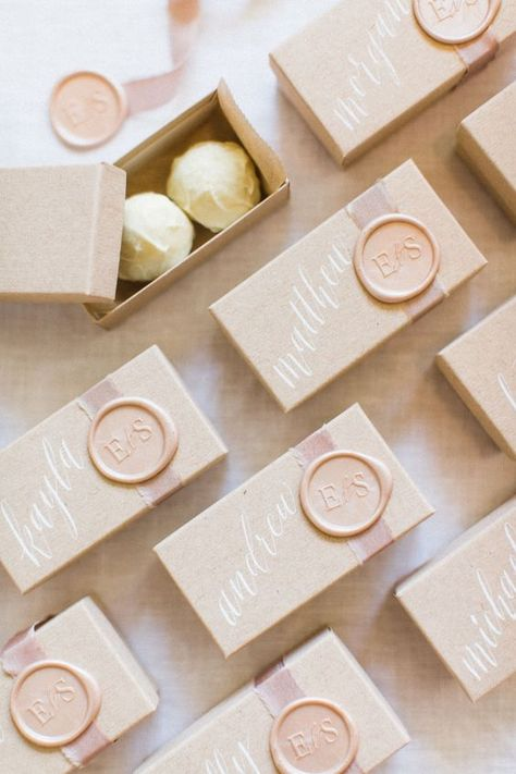 In honor of 2020, here's a list of modern and creative ideas from wedding experts and ahead-of-the-trend, fashion-forward brides. Calligraphy chocolate truffles wedding favors.