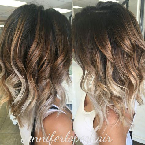 Ash blonde balayage two toned hair..