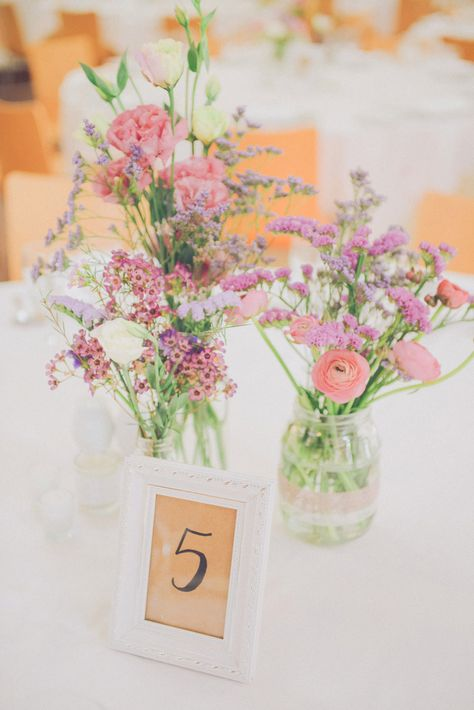 Glass Jars with Pink Flower Stems | Destination Wedding In Portugal | Pastel Colour Scheme | Stylish Bride And Groom | Wedding Tattoos Instead Of Rings | Photography By Adriana Morais Fotografia | http://www.rockmywedding.co.uk/rita-joao/