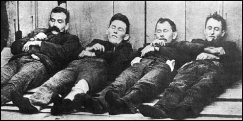 The Dalton gang (Bill Power; Bob Dalton; Grat Dalton, Dick Broadwell), after their unsuccessful attempt to rob two banks at once in Coffeyville, Kansas, in 1892.  Emmet Dalton survived with 23 gunshot wounds.  A fourth Dalton brother, Bill, rode with the Wild Bunch (the Doolin-Dalton gang or Oklahombres, not Butch Cassidy's outlaws).