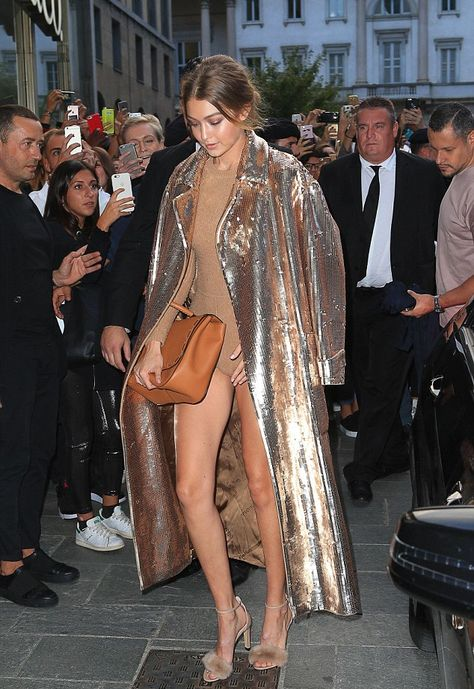 Gigi Hadid displays long legs in sequinned coat at Milan Fashion Week The model certainly knows how to make an impact, turning heads in an incredible glitzy ensemble when she stepped out in Milan on Wednesday evening.