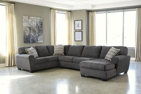 With the contemporary look of the slate toned upholstery surrounding the full rounded arms and plush seat and back cushions, the
