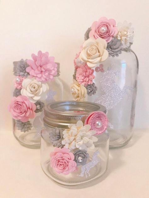 Beautiful mason jars decorated with paper flowers. You can customize what color flowers you want. Great for centerpieces or gifts! Most popular for holding makeup brushes. Can be used for anything! Home Decor or even a nursery...You decide! The possibilities are endless! •All Flower Jars are