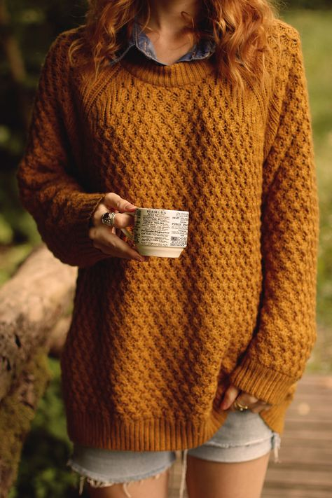 an oversized sweater and some ragged shorts.