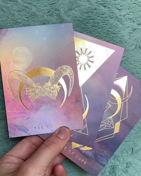 Gold foil illustrations on top of matte holographic foil with pastel dreamscapes. You will fall in love, guaranteed. Find out more on our website www.thethreadsoffate.com #tarot #oracledeck #tarotdeck #tarotreadersofig #oraclereadersofinstagram #metaphysical #witchy #spiritual #witchesofinstagram #witches #fateweavers #crystals #herbalism #divination #magic #magick #tarotgiveaway
