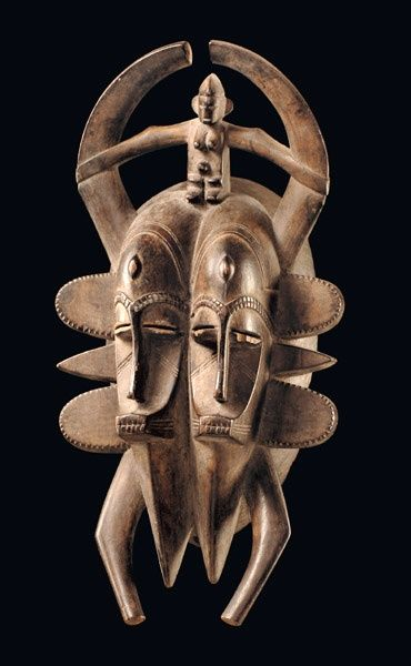"Africa | Double faced mask ""kpelié"" from the Senufo people of the Ivory Coast 