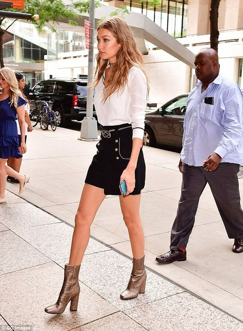 Leggy look: Gigi completed her look with a pair of chunky heeled boots and left her long hair loose and styled in soft waves