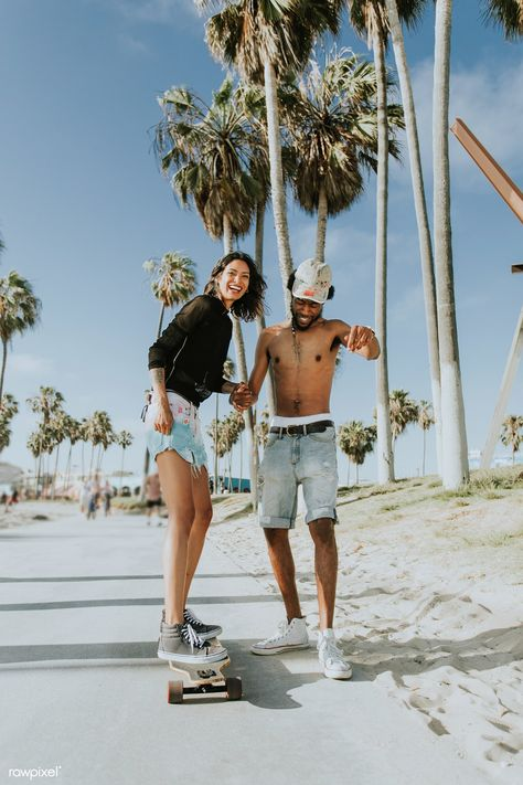Download premium image of Couple longboarding at Venice Beach 462554