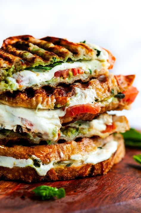 4 Points About Vintage And Standard Elizabethan Cooking Recipes! Caprese Panini With Avocado Basil Pesto - Slices Of Mozzarella, Tomato, Basil, Sourdough Bread And A Fresh Made Avocado Basil Pesto. Delightful Cheesy Goodness From Gourmet Sandwiches, Panini Sandwiches, Healthy Sandwiches, Best Vegetarian Sandwiches, Panini Sandwich Recipes, Caprese Sandwich Recipe, Panini Bread, Pesto Sandwich, Sandwich Ideas