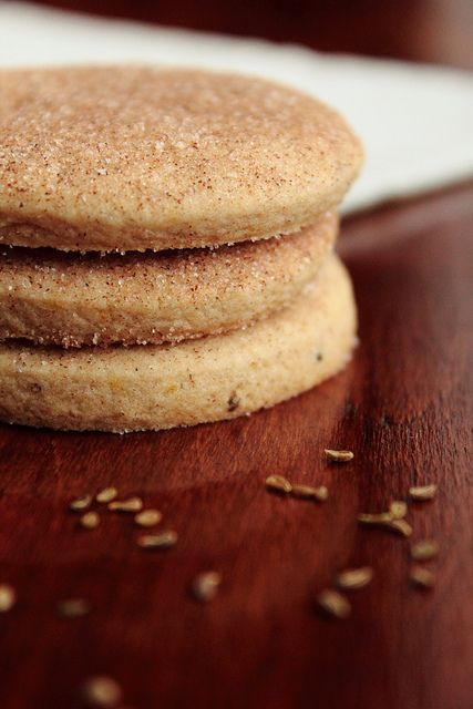 Bizcochitos (cinnamon anise shortbread cookies). One to try :  1 cup salted butter  3/4 cup + 1/2 cup granulated sugar  2 large eggs  1 teaspoon vanilla extract  1 tablespoon orange zest  1 teaspoon anise seed  2 1/2 cups all-purpose flour  1 1/2 teaspoons baking powder  1/2 teaspoon ground ginger  1 1/2 teaspoons ground cinnamon
