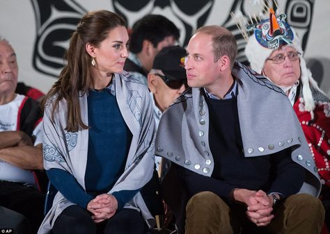 The couple were told 'the design represents all life, not just animals but us as humans'. Pictured, wearing the blankets