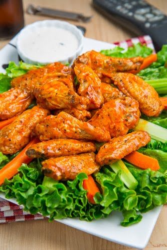 Crispy Baked Buffalo Wings -- The trick is to toss wings in oil, bake, *then* toss in a hot sauce and butter combo.