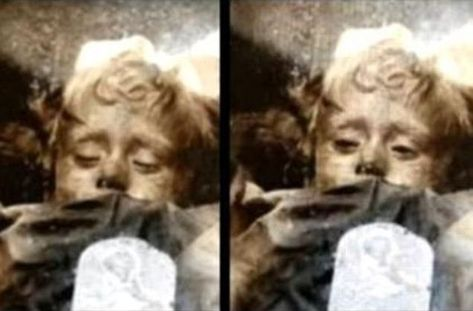 """One of the world's best preserved mummies, Rosalia is the most famous among some 8,000  mummies lining the catacombs beneath the Capuchin convent in Palermo, Sicily.  Nicknamed """"sleeping beauty,"""" she looks like a 2-year-old baby taking a nap. Poking above a blanket, her peaceful face is framed by curly blond hair, while a ribbon is still tied around her head."""