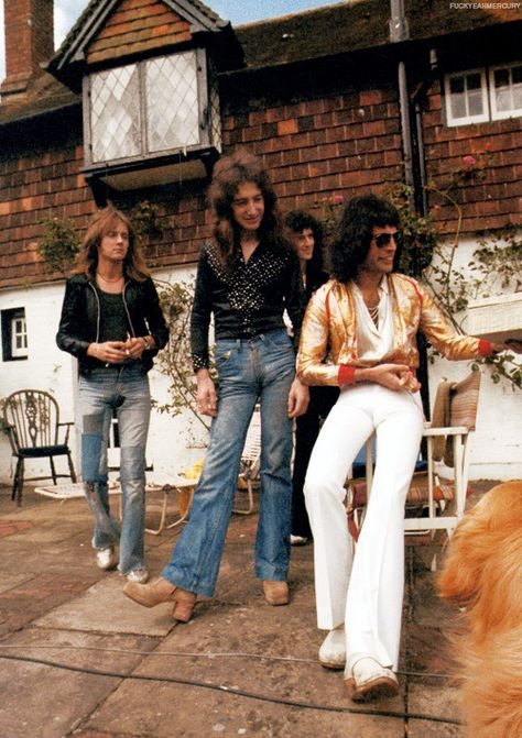 "fuckyeahmercury: "" Queen at Ridge Farm, 1975. Photo by Watal Asanuma "" I think I'm actually most impressed by John's, uh, wardrobe ensemble here."