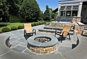 Homeowners Todd and Nacny Hale refurbish their backyard- Look at the results! The fire pit is just a few steps from the hot tub and enclosed grilling area, which features Bahama shutters.