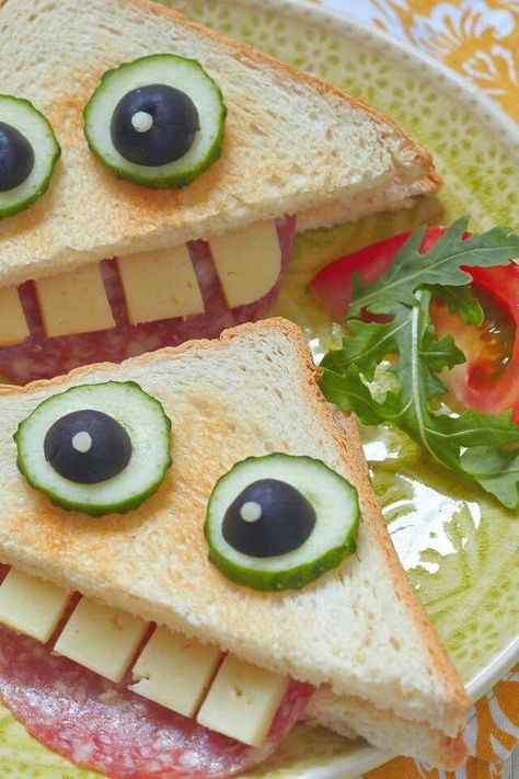 Kid's lunch, sandwich made with meat, cheese, cucumber, olives, fun food, face