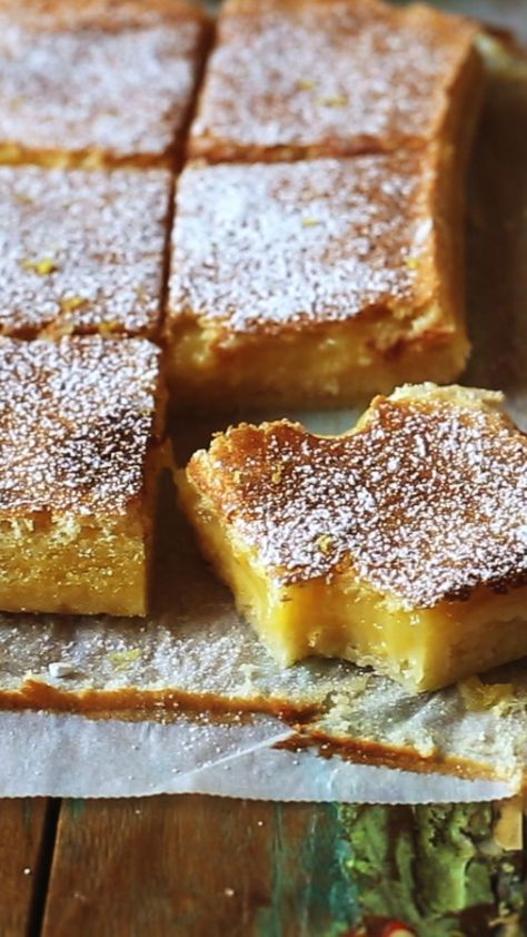 These Lemon Bars are sour and sweet and very easy to make. Buttery shortbread crust meets tangy lemon curd filling. Just 7 ingredients! You won't be able to stop eating these. #lemonbars #lemon #sweets #desserts