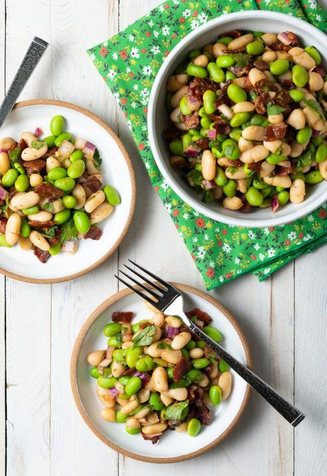 The perfect summer salad that can sit out for long periods of time and is super easy to make! #ASpicyPerspective #edamamesalad #whitebeansalad #bacon #whitebeanedamamebaconsalad #summersalad #summersidedish #partydish #partysidedish #easysidedish #easyrecipe #simplerecipe #lowcooktime