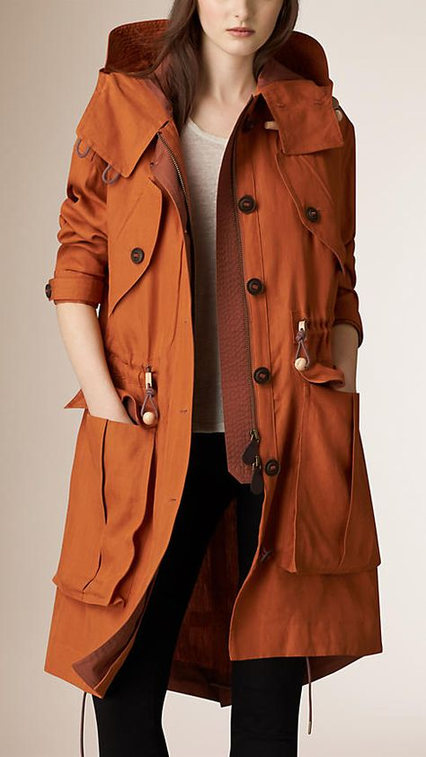 Burberry Copper Orange Linen Parka with Bellows Pockets - A linen parka jacket with oversized bellow pockets. The check-lined detail jacket closes with a concealed zip and button placket, with toggle drawcords at the hood, waist and hem. Discover the women's outerwear collection at Burberry.com